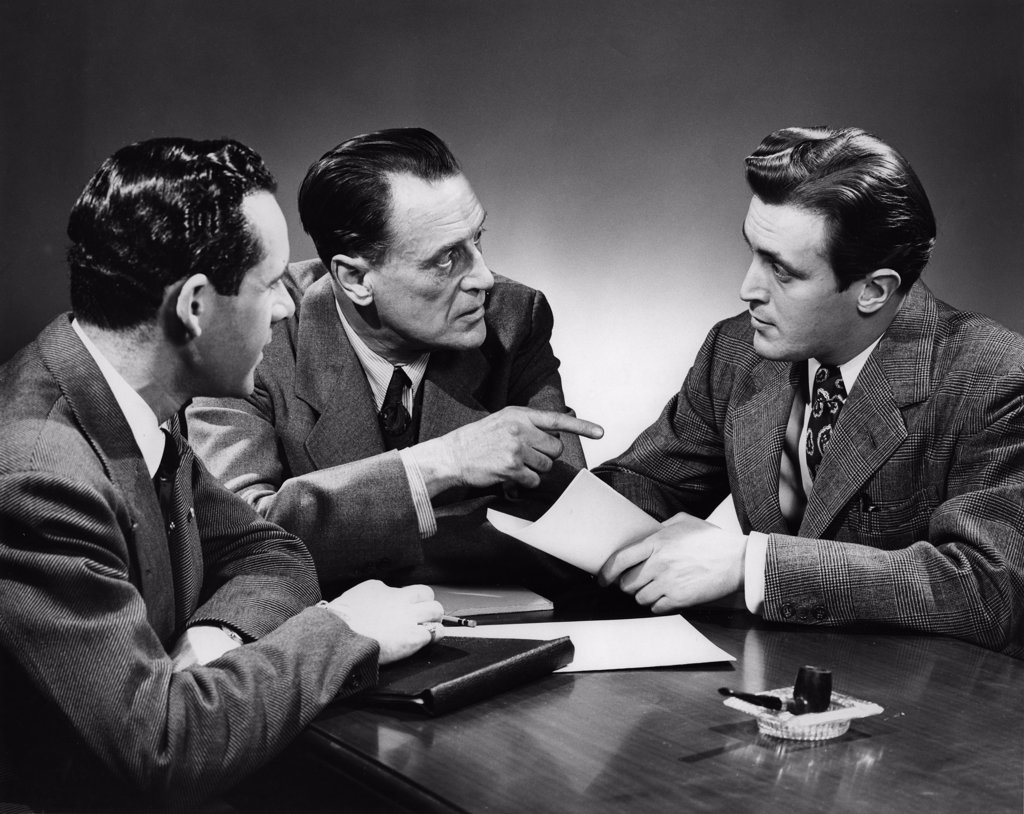 Stock Photo: 255-15539 Vintage photograph of businessmen in meeting