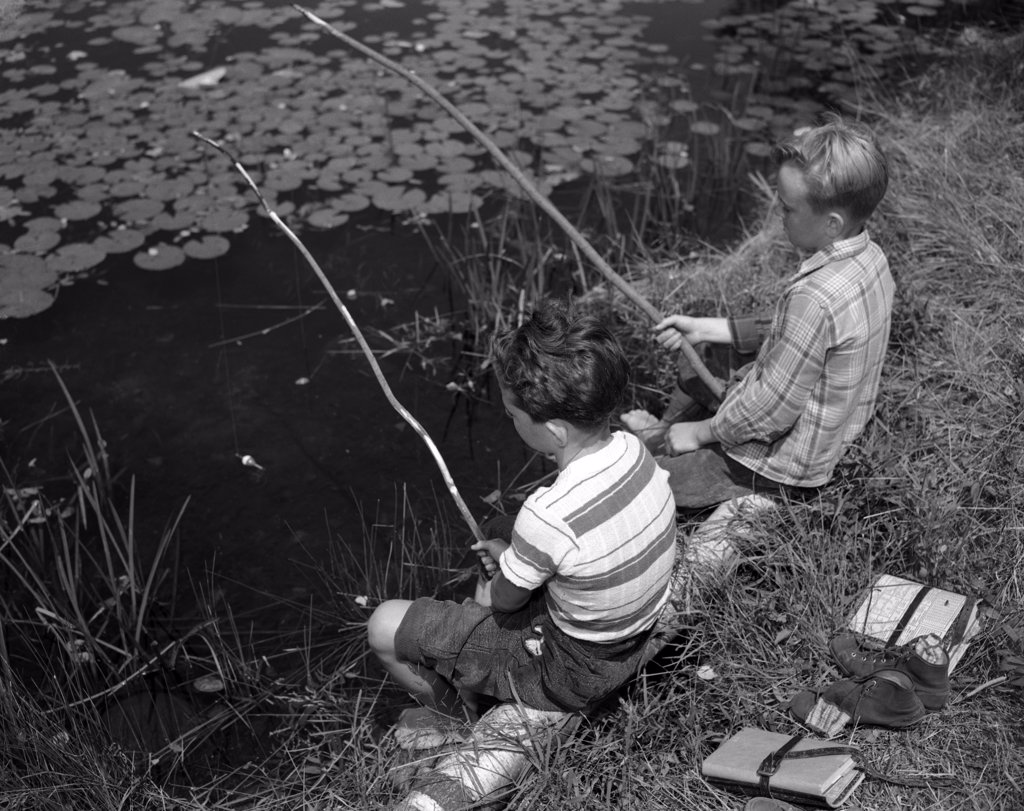 Stock Photo: 255-16344 Two boys sitting and fishing with homemade fishing rod