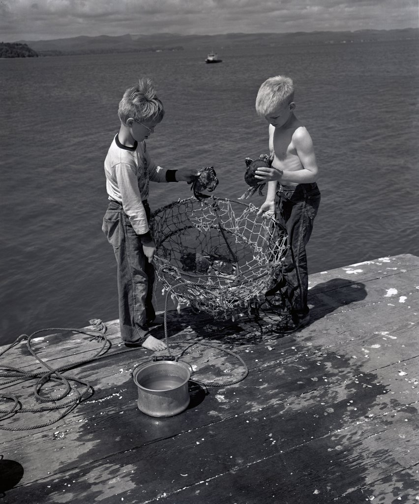 USA, Washington, Ocean Park, Boys fishing : Stock Photo