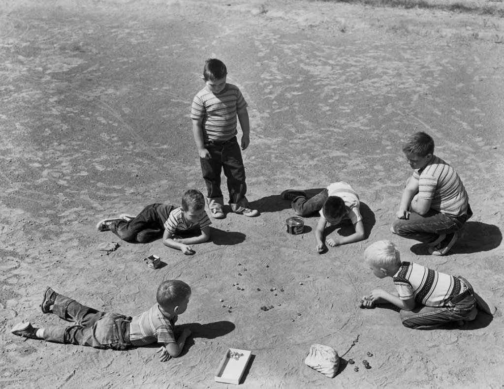 Stock Photo: 255-16562 High angle view of a group of boys playing marbles