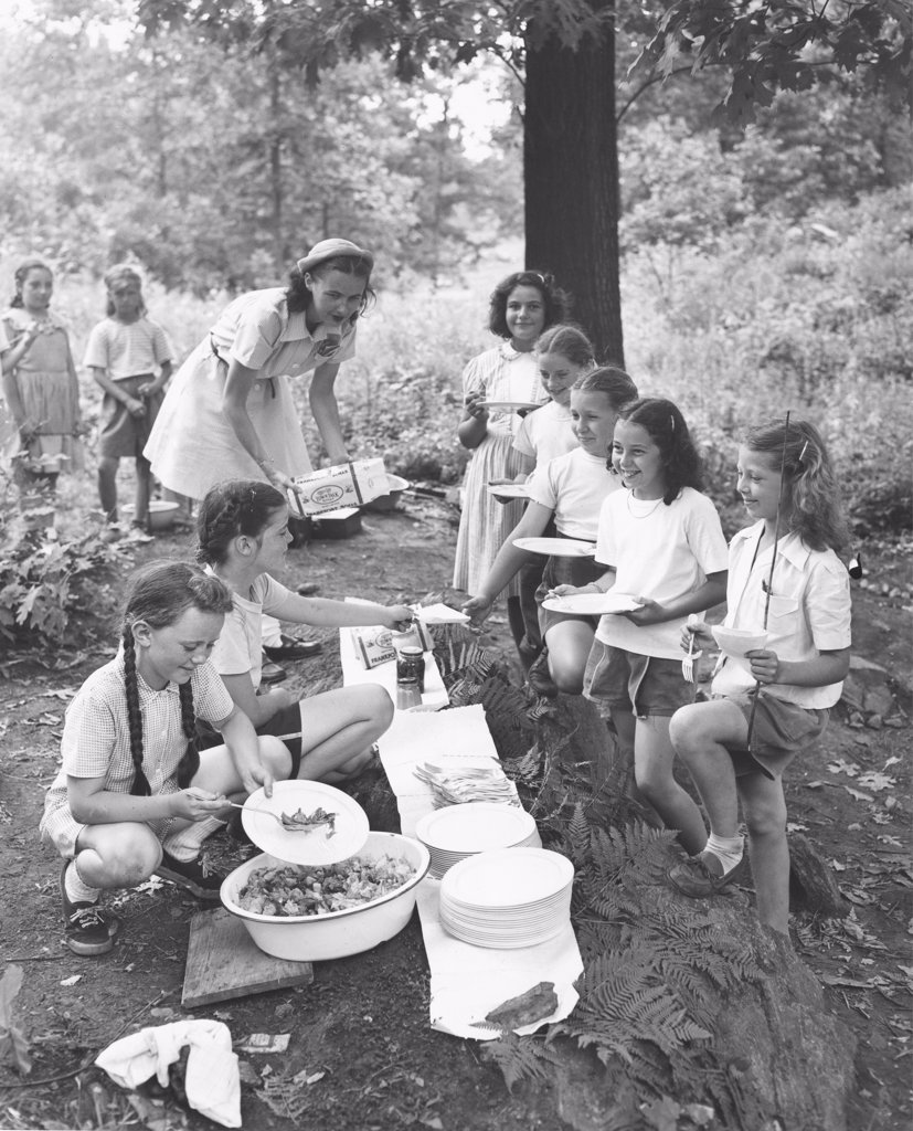 Stock Photo: 255-16624 Girls serving food to other campers