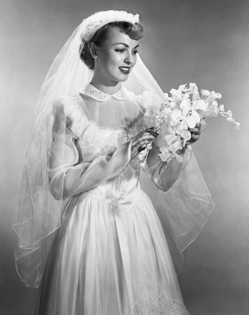 Bride smiling and holding a bouquet : Stock Photo