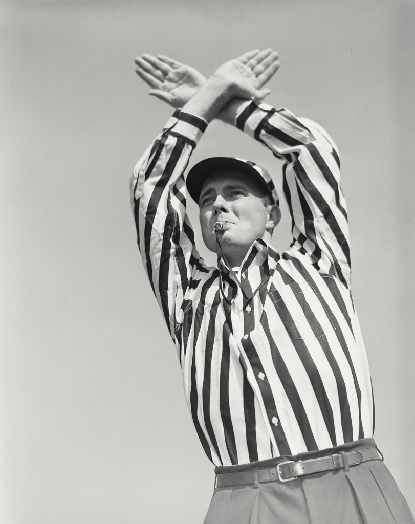 Stock Photo: 255-18812B Referee giving a time out signal