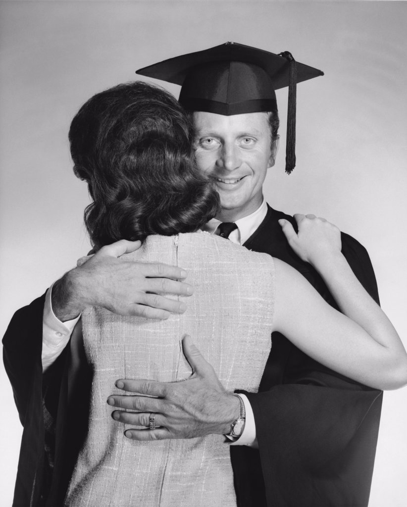 Stock Photo: 255-18855 Close-up of a mid adult male graduate embracing a woman