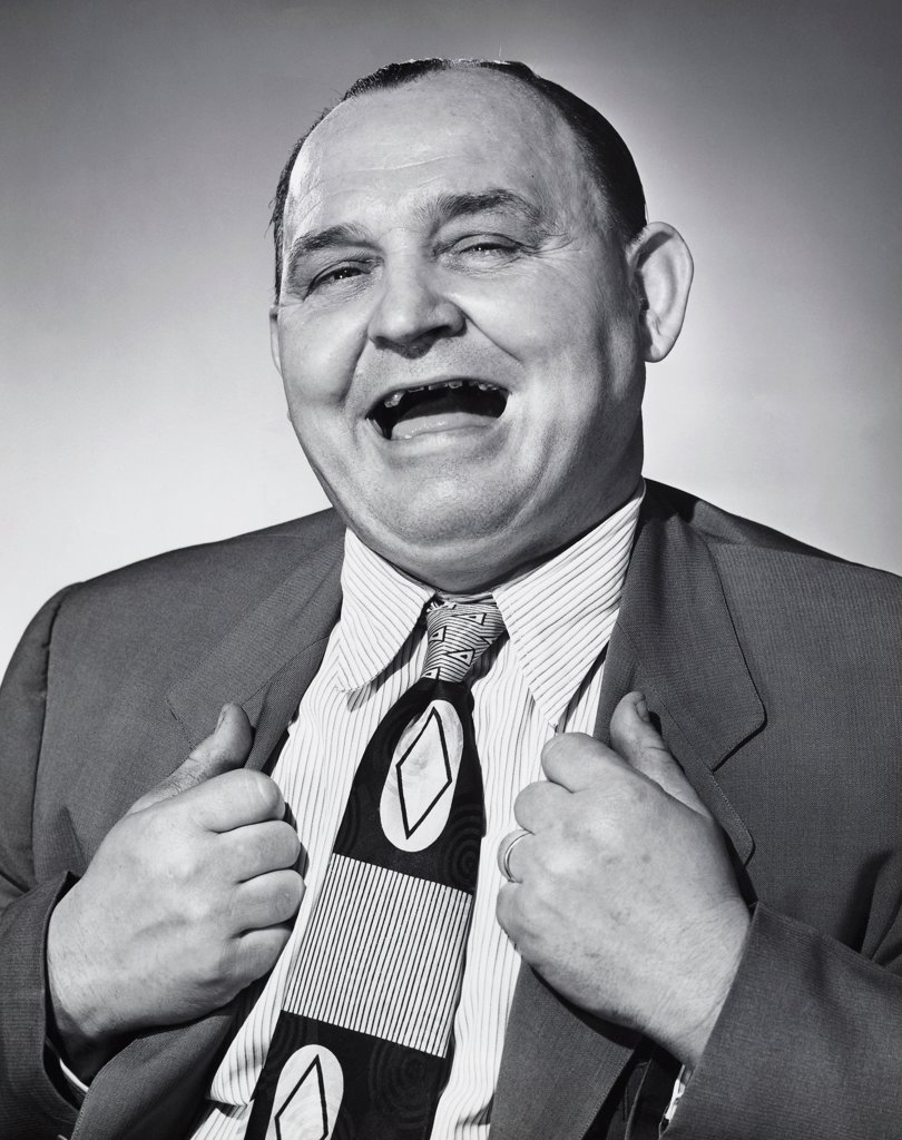 Stock Photo: 255-1890 Portrait of a businessman laughing