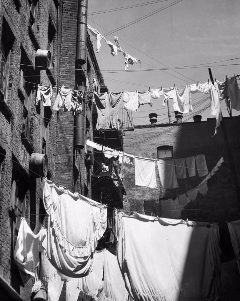 Low angle view of clothes hanging on clotheslines : Stock Photo