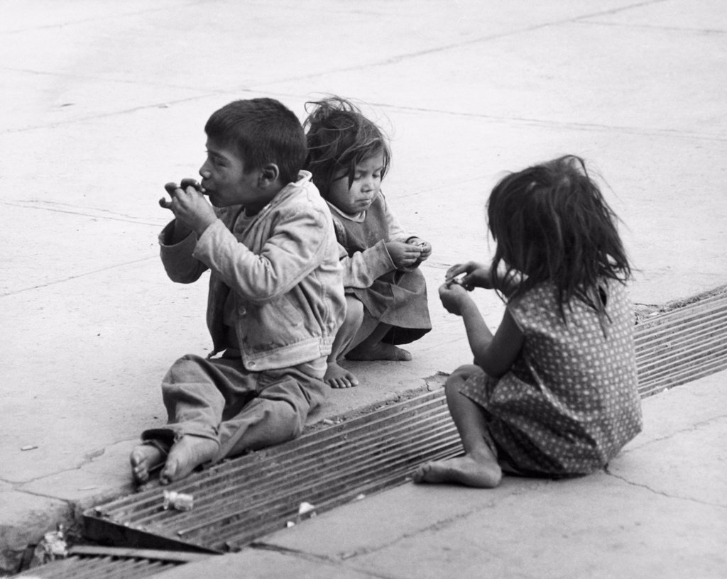 Stock Photo: 255-1997 Boy and two girls sitting on a road, Mexico