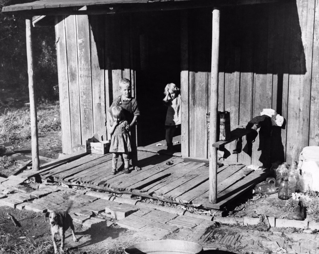 High angle view of three children standing on the porch, Kentucky, USA : Stock Photo