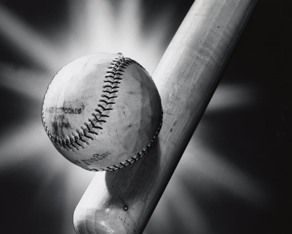 Close-up of a baseball and a baseball bat : Stock Photo