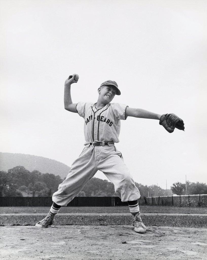 Stock Photo: 255-20400 Baseball player throwing a baseball
