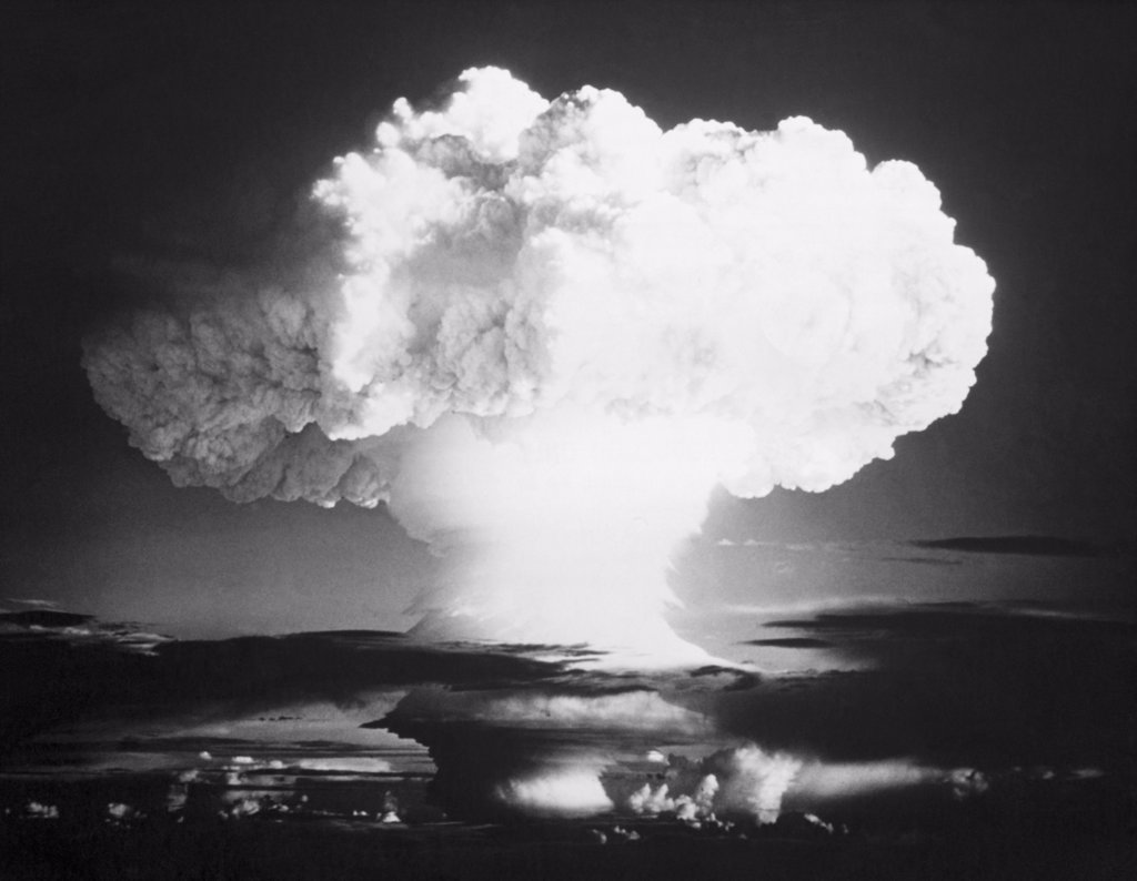 Mushroom cloud formed by an atomic bomb explosion : Stock Photo