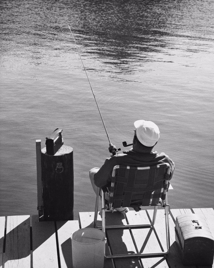Rear view of man fishing : Stock Photo