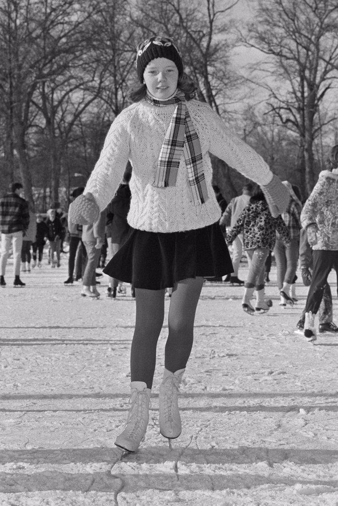 Stock Photo: 255-21629 Girl ice-skating in park