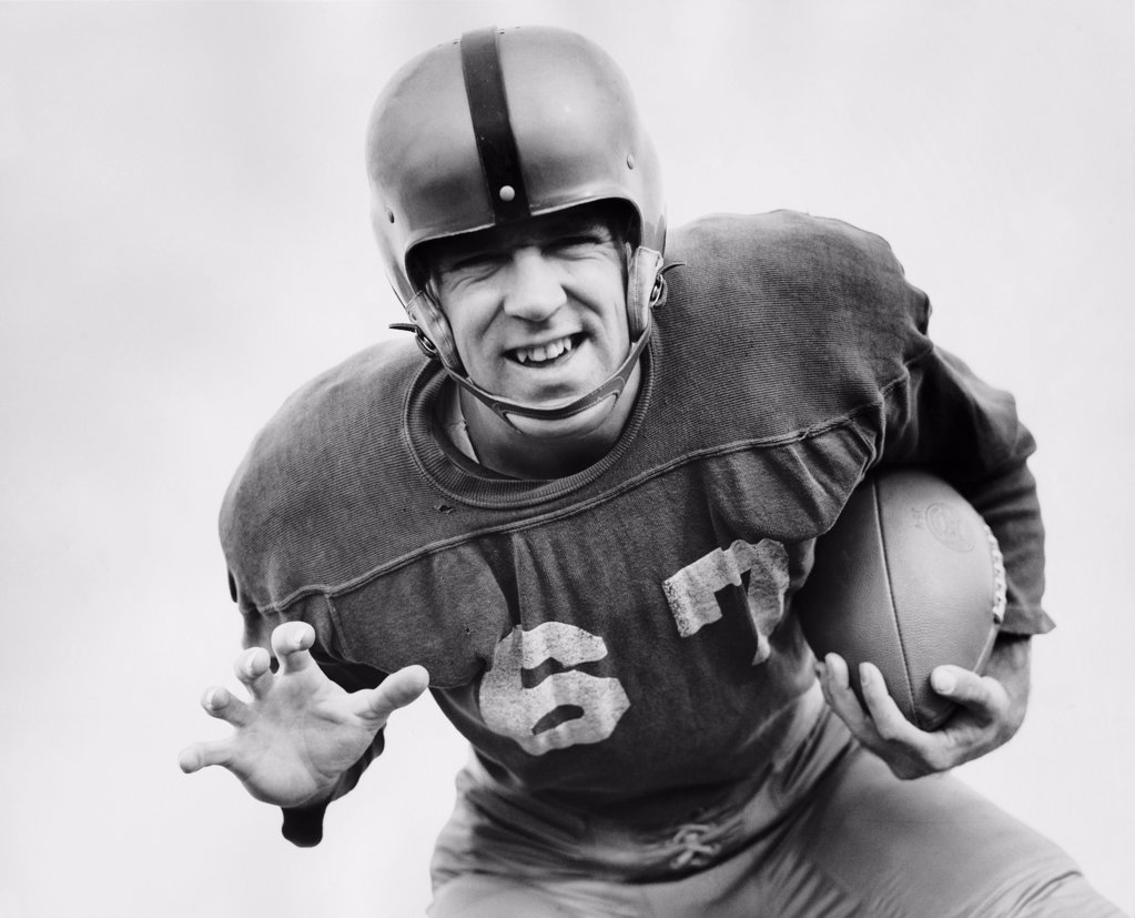 Stock Photo: 255-21762 Close-up of a football player holding a football