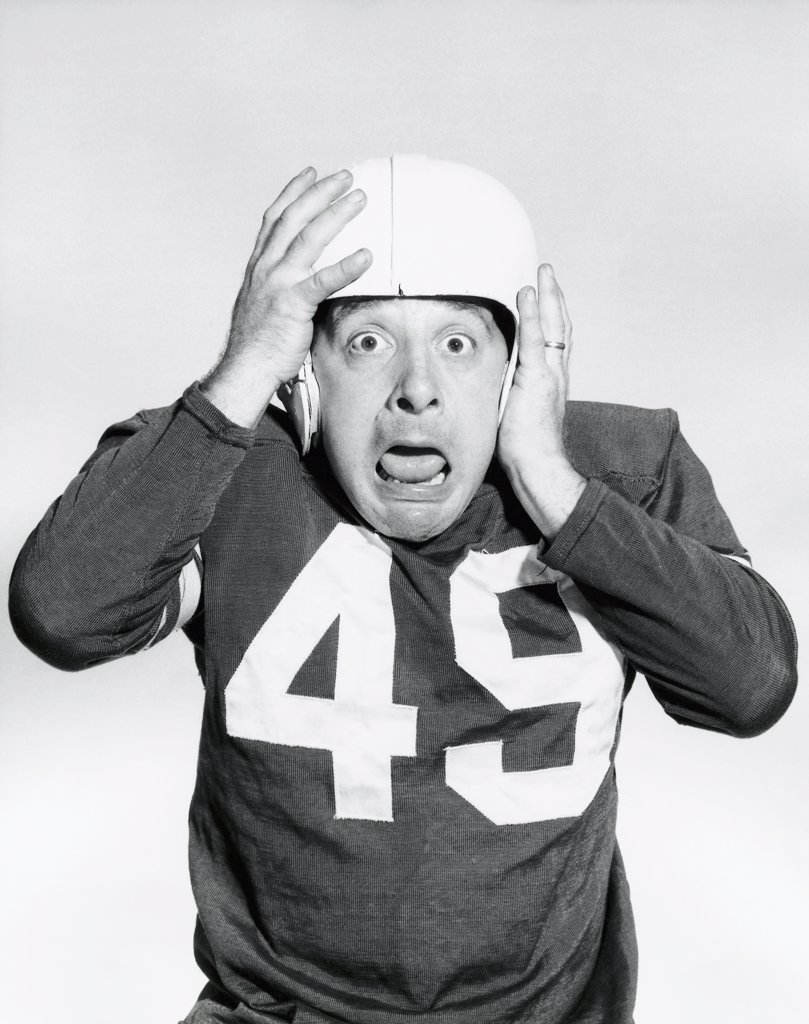 Stock Photo: 255-21788 Portrait of a football player wearing a football uniform