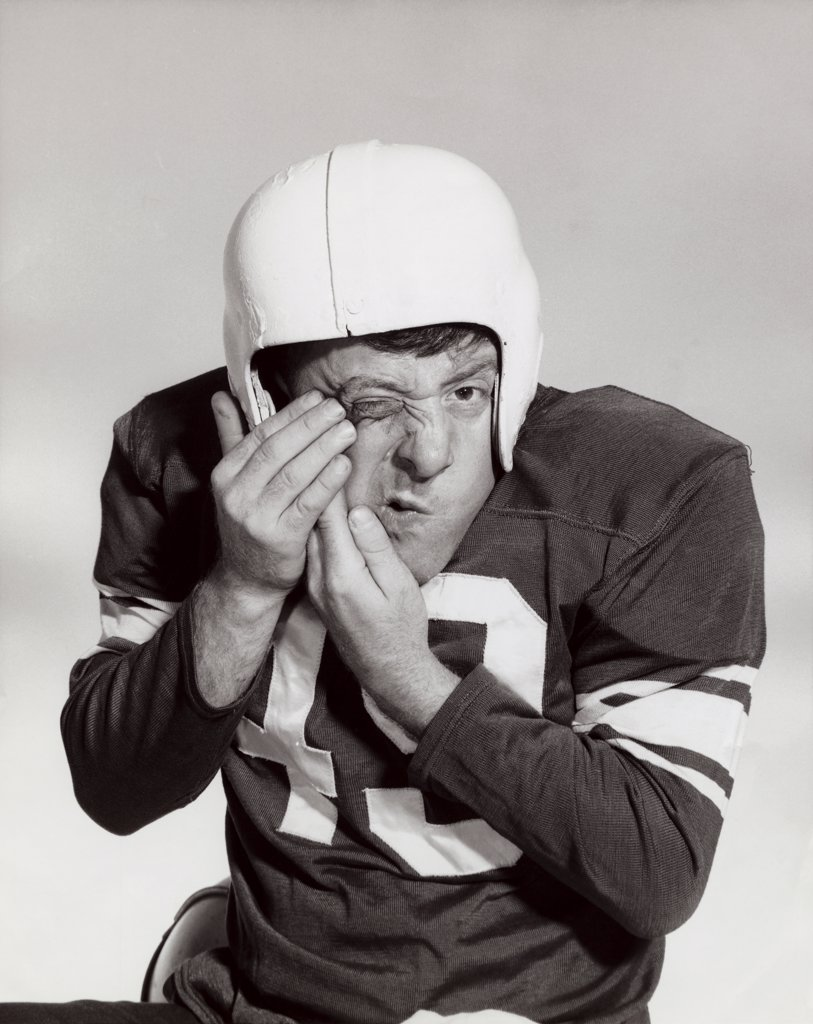 Close-up of an injured football player : Stock Photo