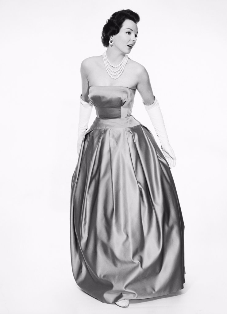 Young woman wearing an evening gown : Stock Photo