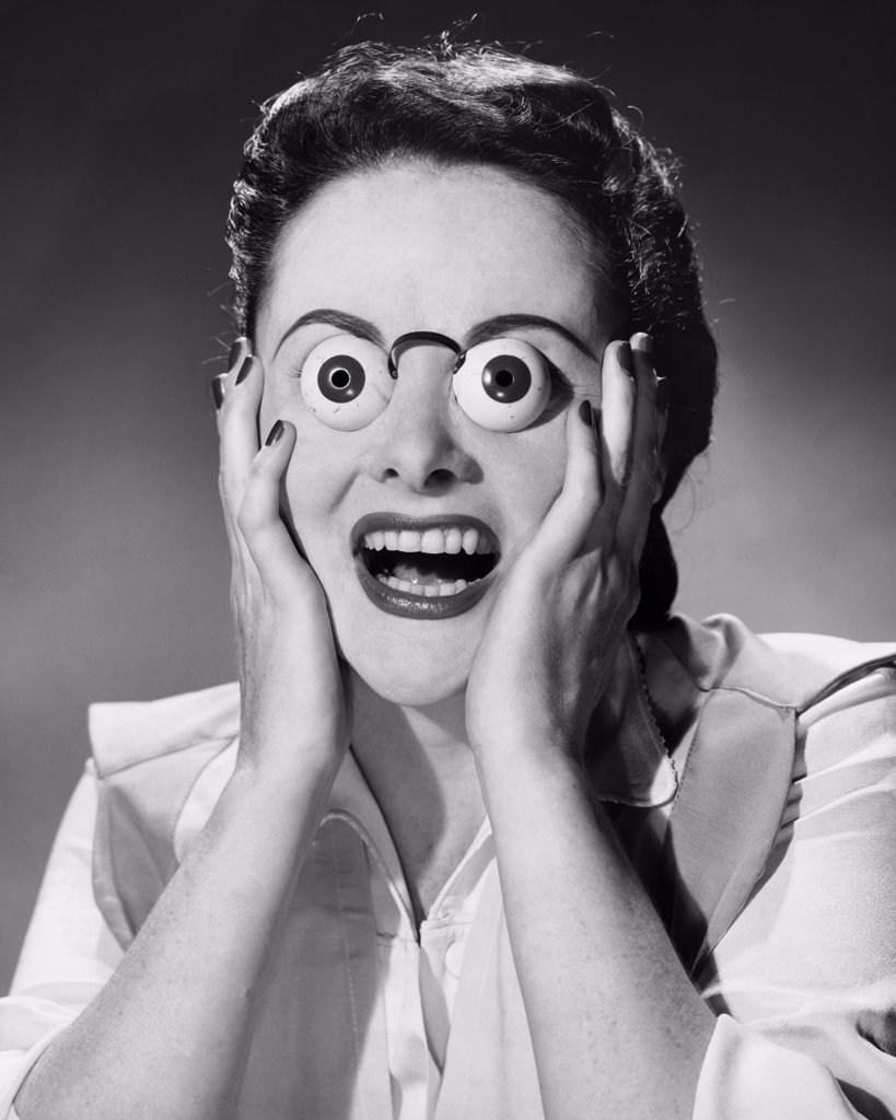 Surprised woman with funny glasses : Stock Photo