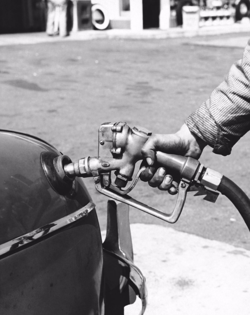 Stock Photo: 255-22965 Gas station attendant filling up a car