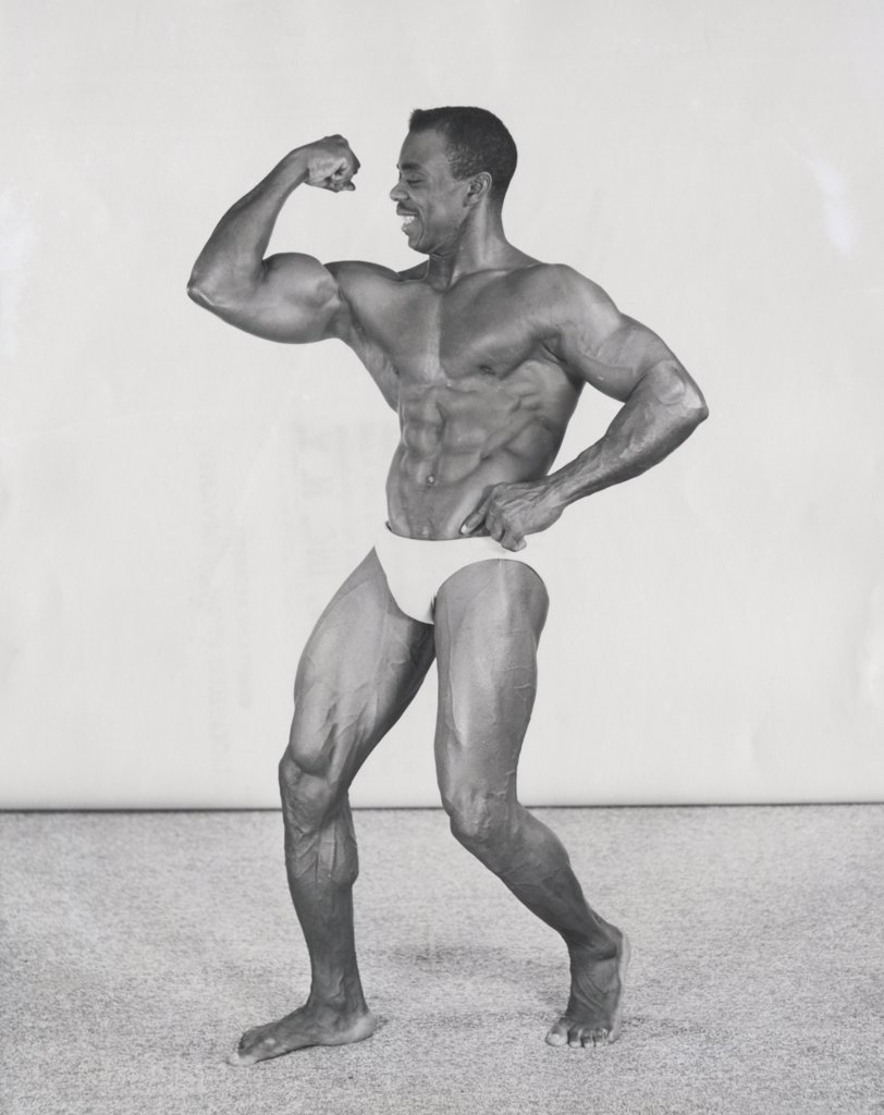 Male body builder flexing his muscles : Stock Photo