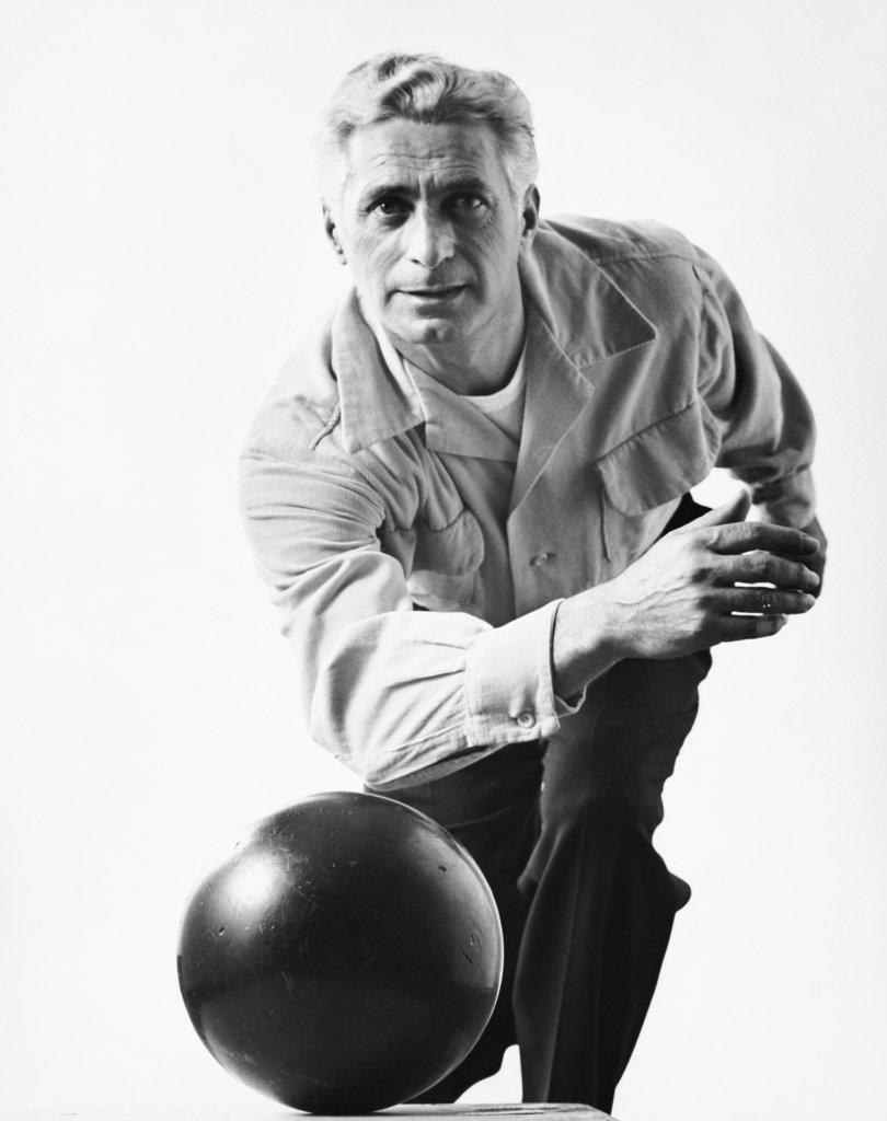 Stock Photo: 255-24274 Mature man bowling