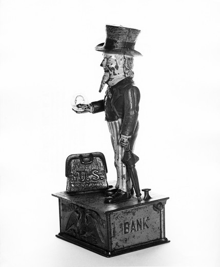 Close-up of a figurine of Uncle Sam on a mechanical bank : Stock Photo