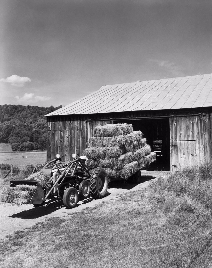 Tractor in front of a barn, Quechee, Vermont, USA : Stock Photo