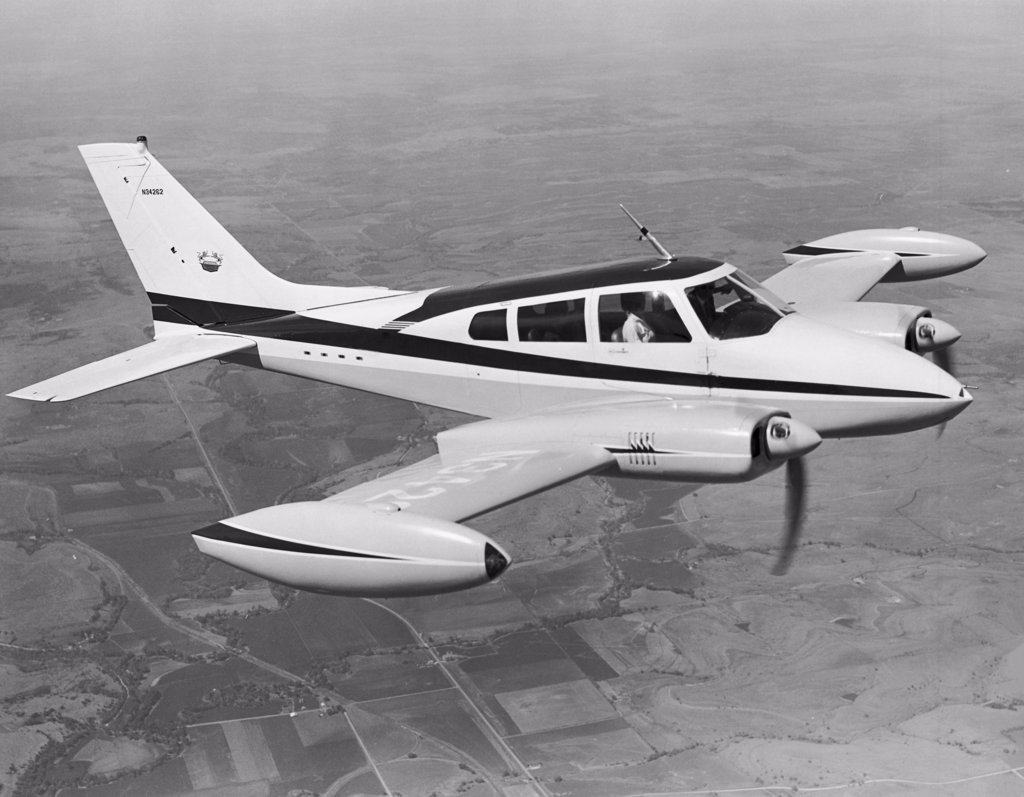 High angle view of an aircraft in flight, Cessna 310F : Stock Photo
