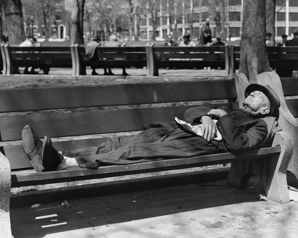 Stock Photo: 255-27739 Senior man sleeping on a park bench