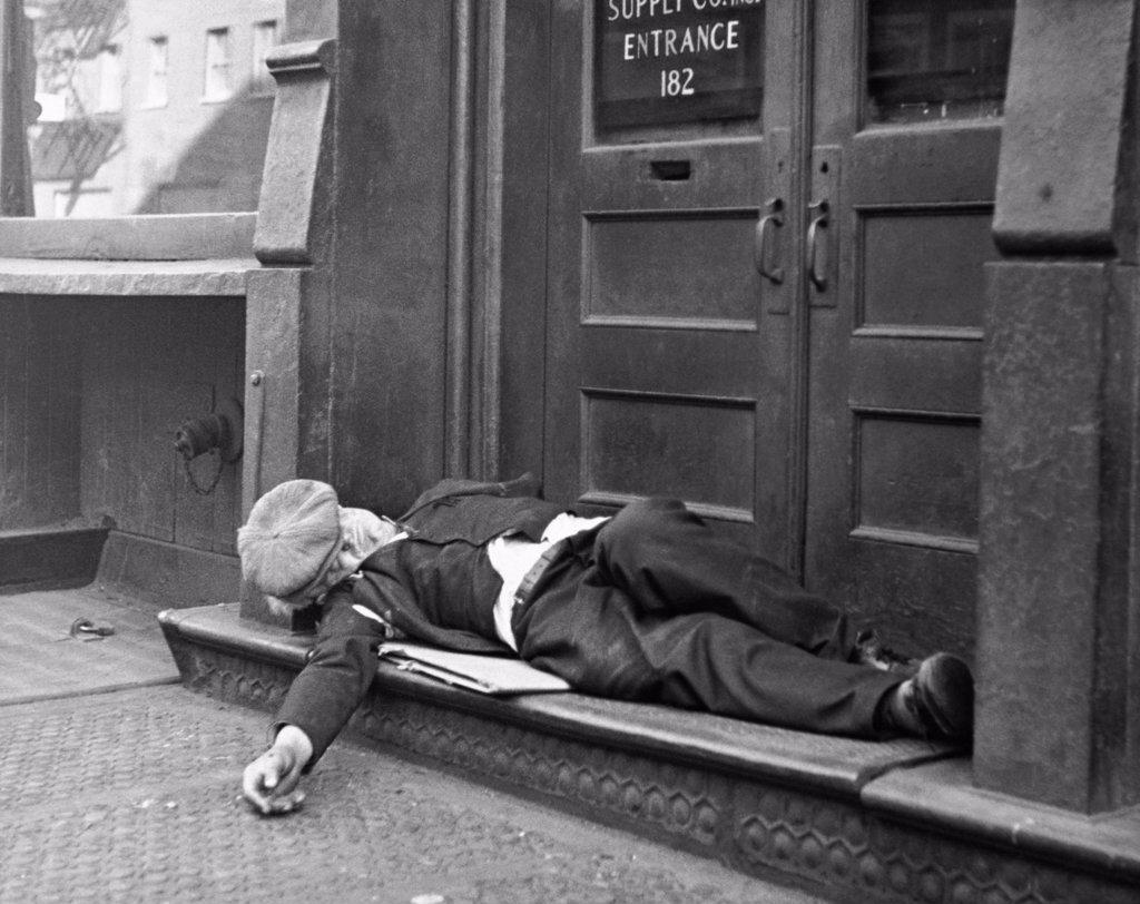 Stock Photo: 255-27741 Man sleeping on the doorstep, Bowery, Manhattan, New York City, New York State, USA