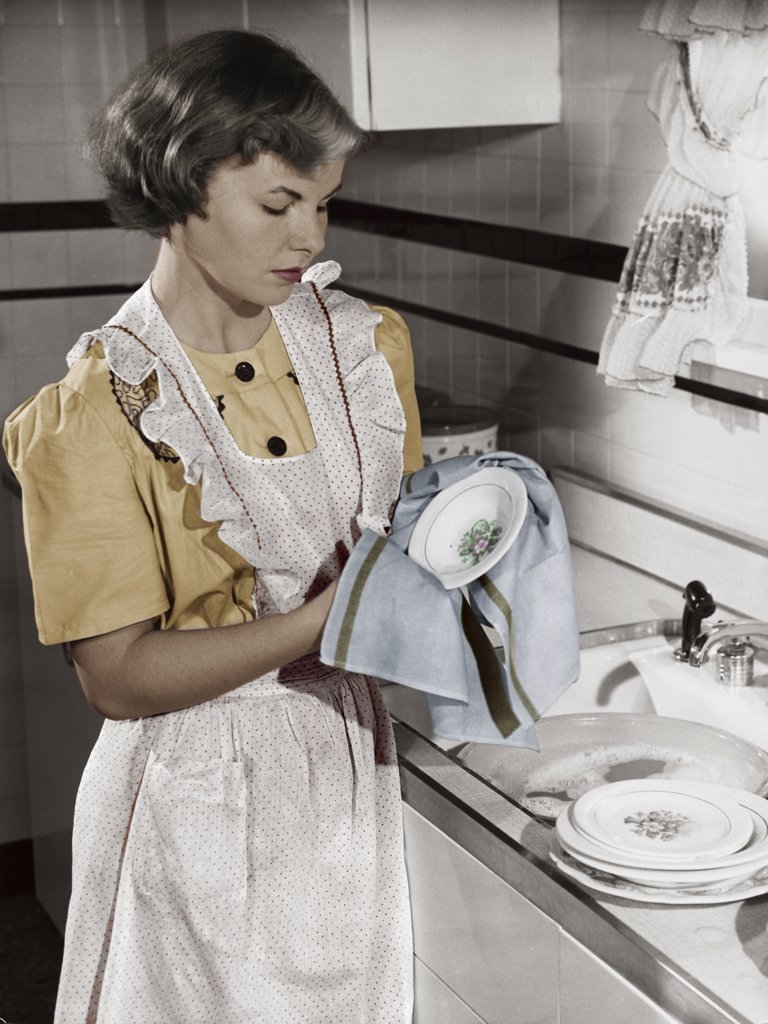 Stock Photo: 255-27954A Young woman cleaning dishes in kitchen