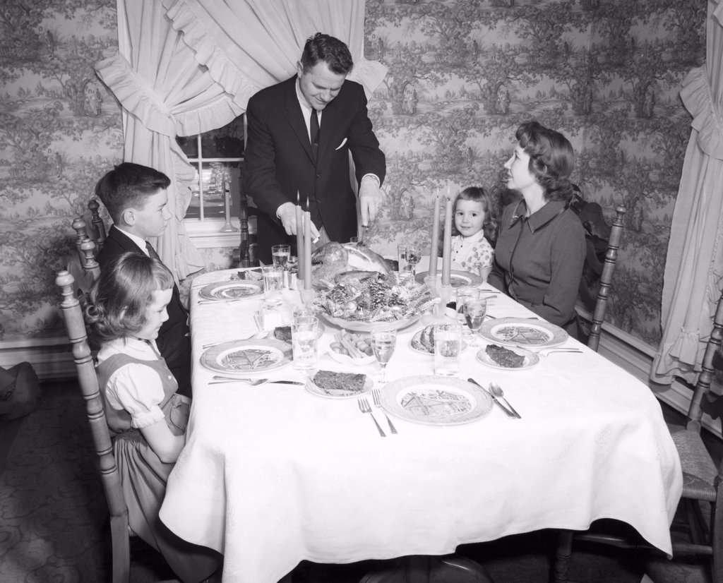 Stock Photo: 255-28777 Family with children at dining table on Thanksgiving Day