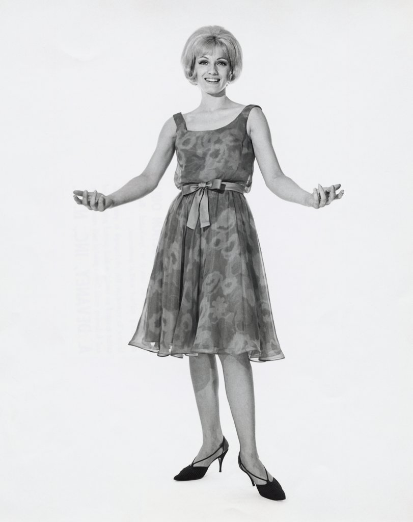 Stock Photo: 255-29046 Portrait of a young woman with her arms outstretched