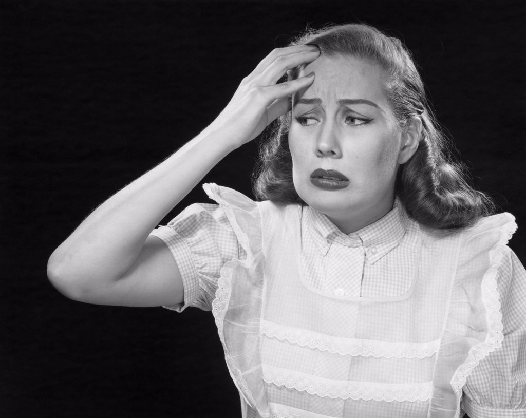 Mid adult woman suffering from a headache : Stock Photo