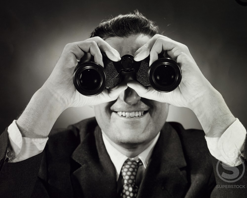 Stock Photo: 255-3055 Close-up of a man looking through binoculars