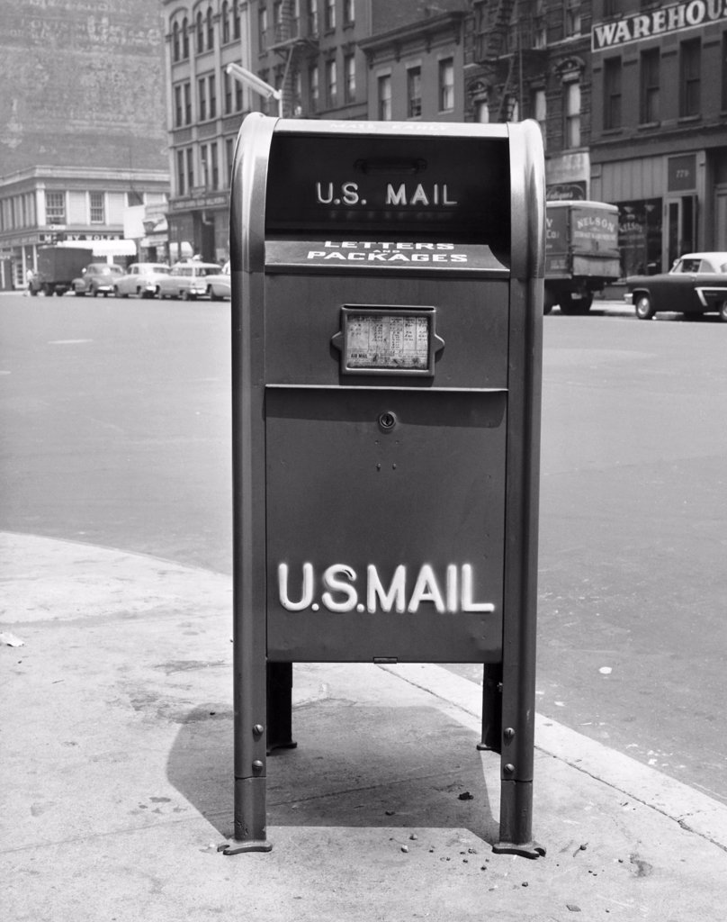 Stock Photo: 255-32630 Mailbox on a sidewalk