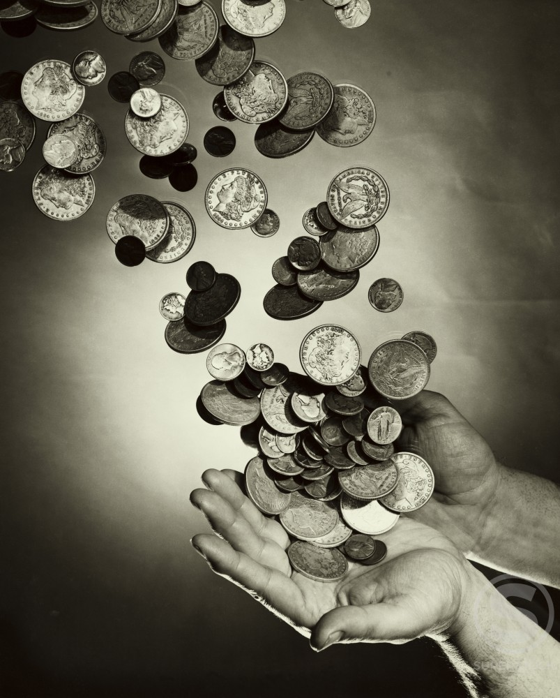 Stock Photo: 255-3327 Close-up of coins falling on a person's hands
