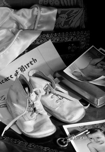 Stock Photo: 255-3443A Shoes on baby photos and birth certificate
