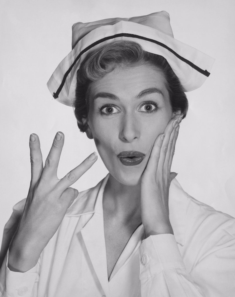Stock Photo: 255-34548 Portrait of a female nurse gesturing and looking surprised