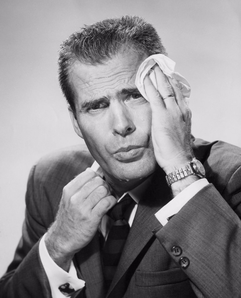 Stock Photo: 255-34765 Close-up of a mature man wiping his forehead