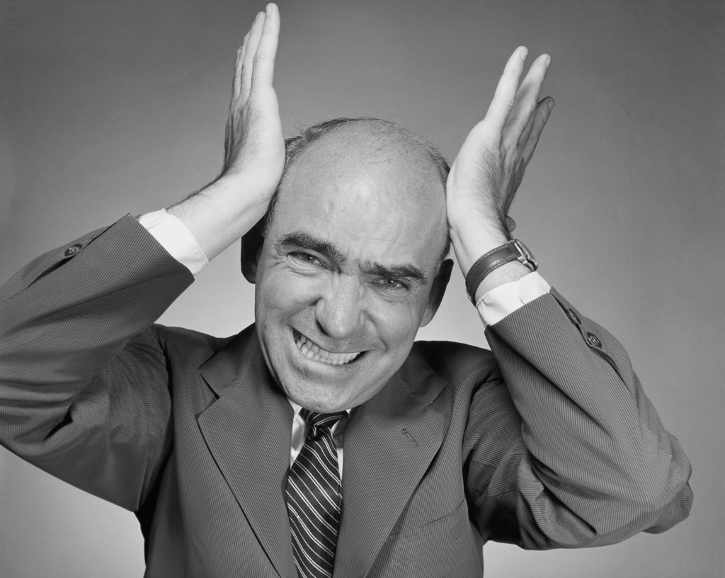 Stock Photo: 255-34767 Studio portrait of mature man with head in hands