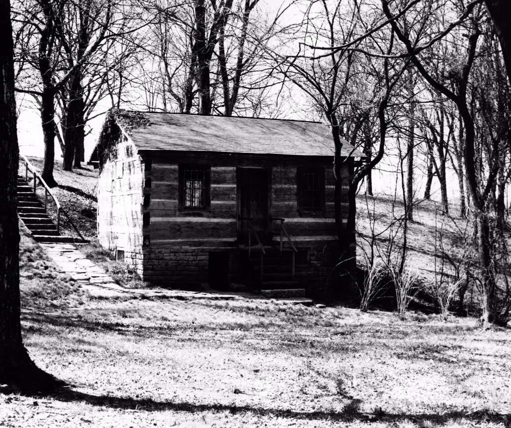Stock Photo: 255-35672 USA, Kentucky, Bardstown, My Old Kentucky Home State Park, log cabin in forest, replica of Judge John Rowan's law office