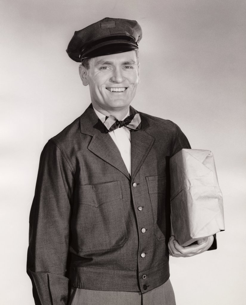 Stock Photo: 255-3569 Portrait of a delivery person delivering a package