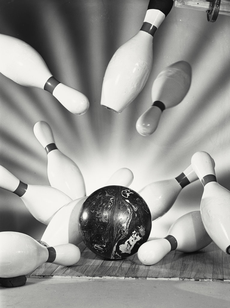 Stock Photo: 255-3660 Close-up of a bowling ball hitting bowling pins