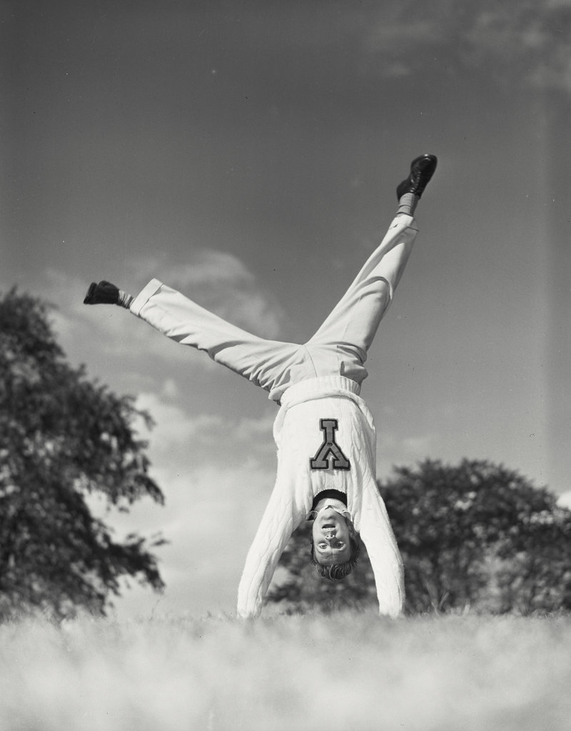Stock Photo: 255-3672 Male cheerleader doing a cartwheel