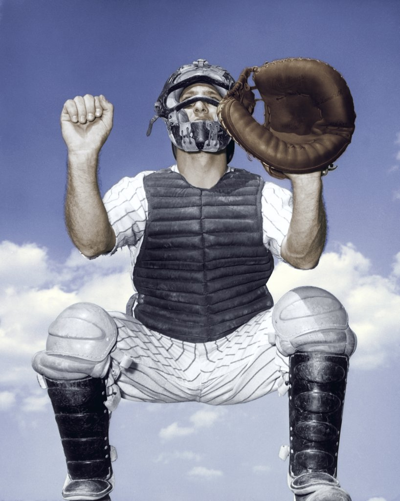 Stock Photo: 255-3687A Close-up of a baseball catcher crouching