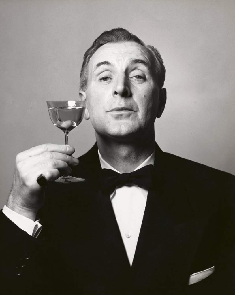 Stock Photo: 255-3760 Portrait of a mature man holding a martini glass