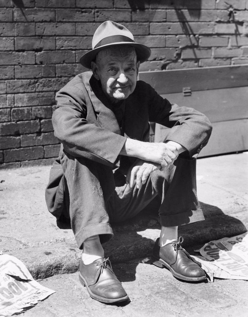 Stock Photo: 255-3761 Portrait of a mature man sitting on the street