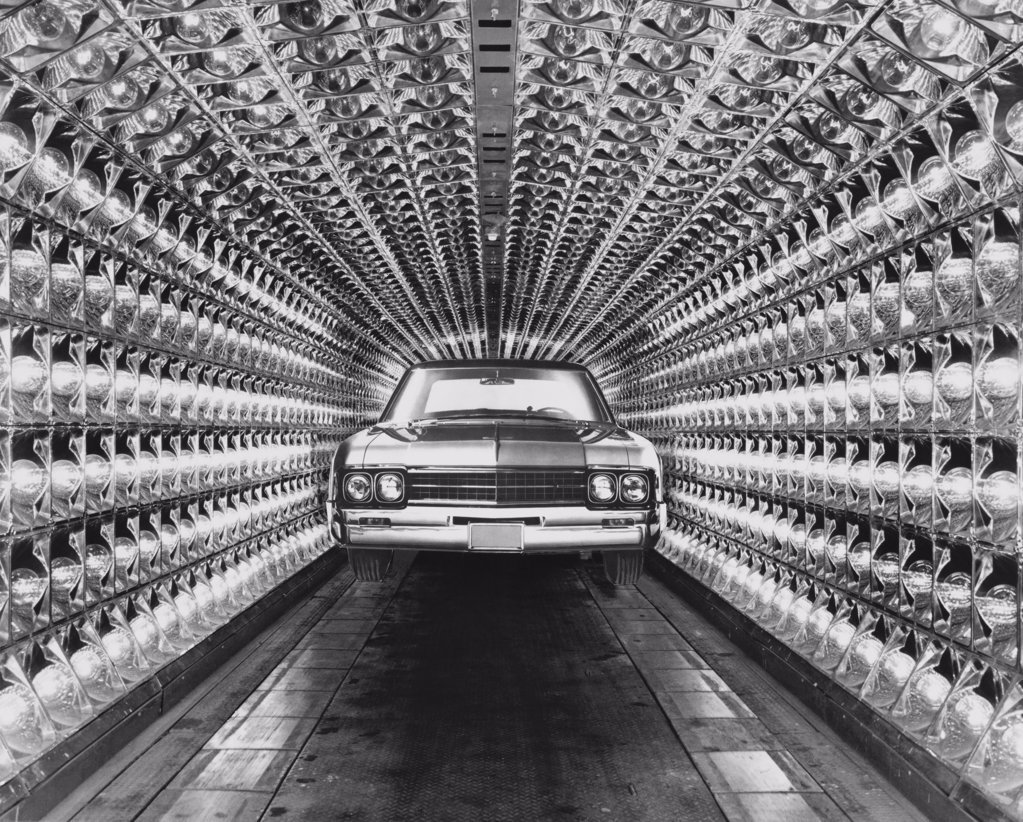 Stock Photo: 255-37984 Car under heat lamps in a car paint drying unit of a factory