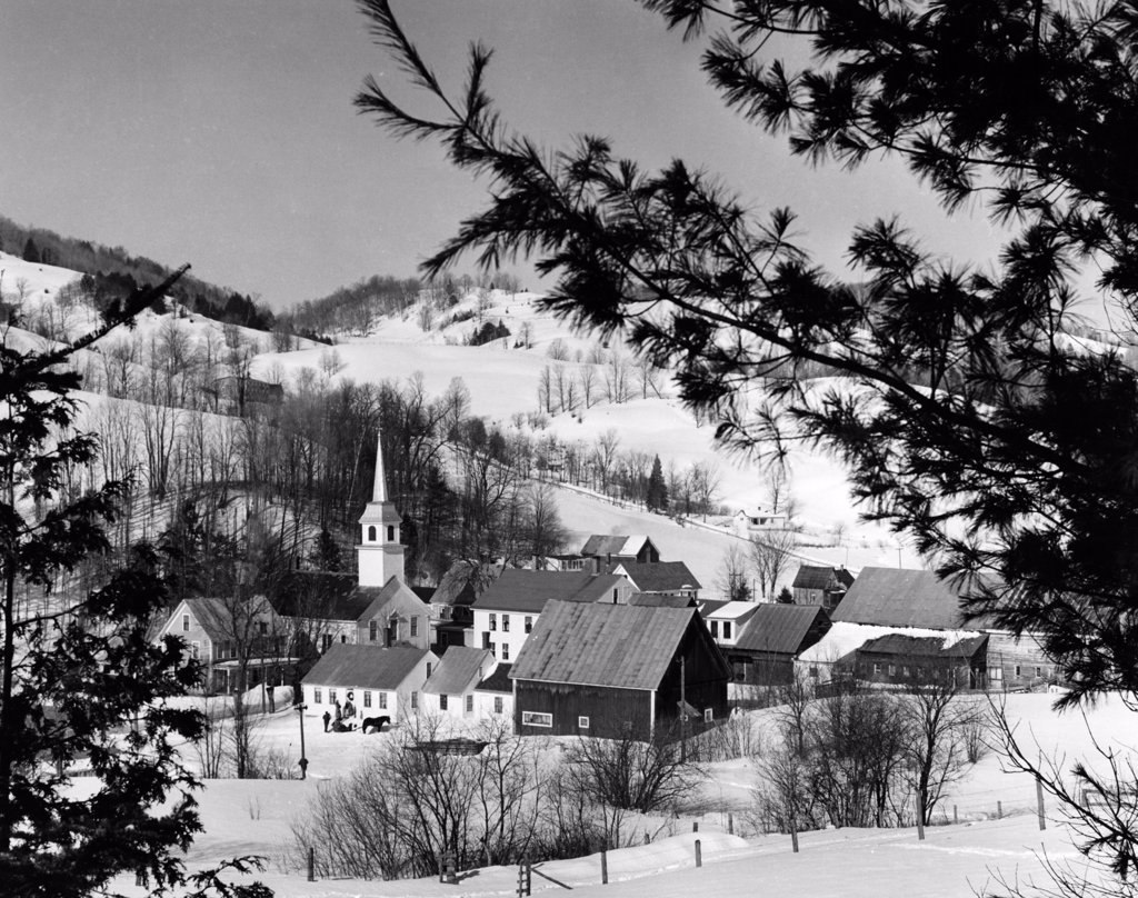 Stock Photo: 255-38065 USA, Vermont, East Corinth, houses on snow covered landscape